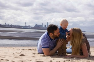 The Jones family with the Liverpool waterfront behind them