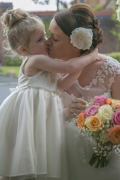 A mum and daughter at a wedding image by Inspired By Joseph oldham wedding photographer