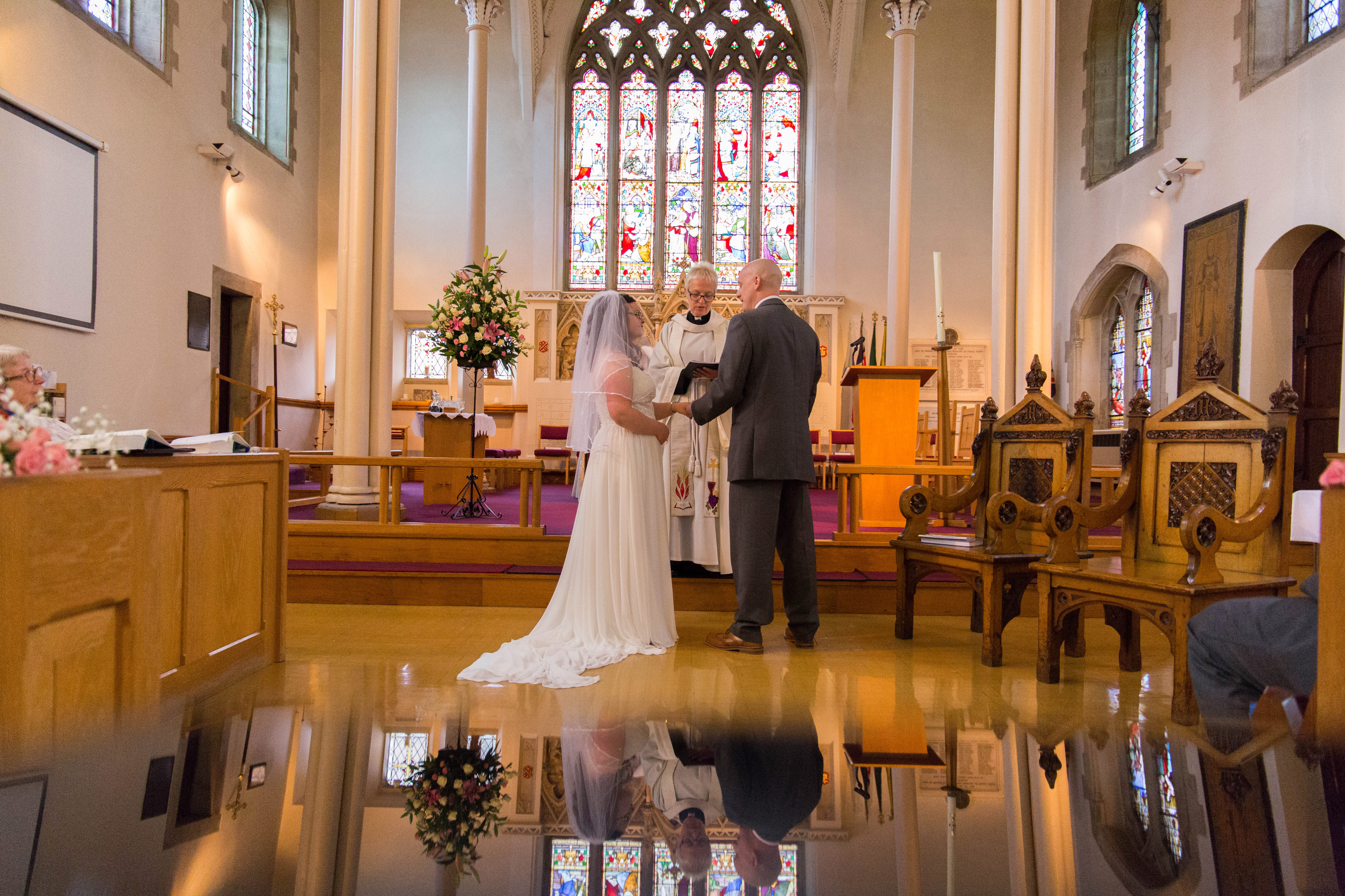 Oldham wedding photographer - bride and groom at wedding ceremony