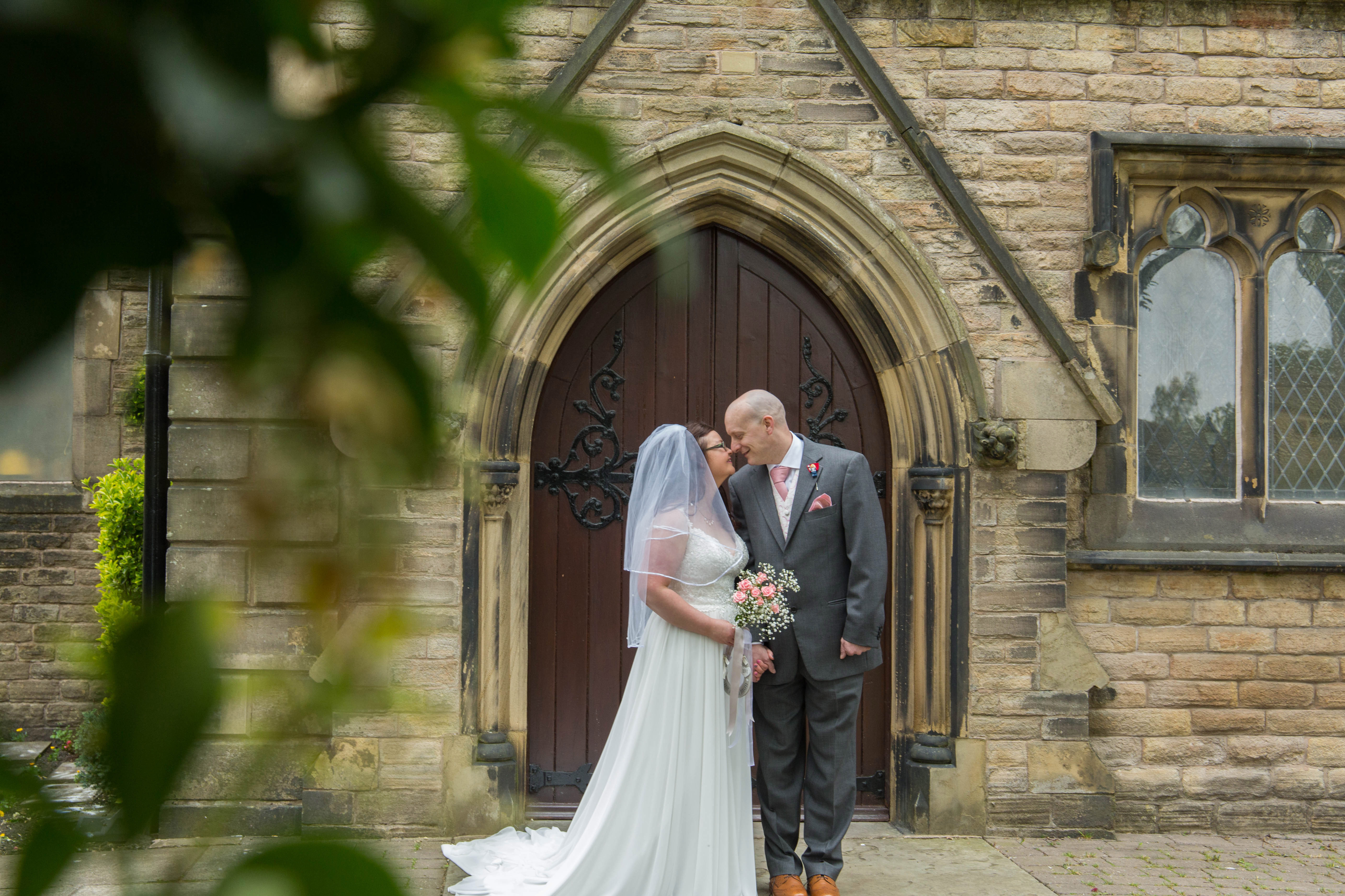 Oldham wedding photographer - bride and groom